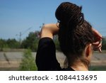 a girl with dreadlocks looks... | Shutterstock . vector #1084413695