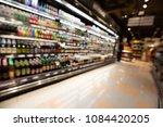 defocused blur of supermarket... | Shutterstock . vector #1084420205