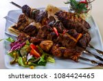 barbeque meat mix plate with...   Shutterstock . vector #1084424465