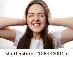 emotional girl covers her ears... | Shutterstock . vector #1084430015