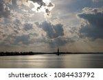 belltower on volga river at... | Shutterstock . vector #1084433792