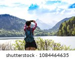 rear of young man  takes... | Shutterstock . vector #1084464635