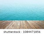 blue sea wave view brown wood... | Shutterstock . vector #1084471856