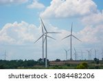 windmills for electric power... | Shutterstock . vector #1084482206