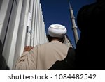 an activist attends a rally to... | Shutterstock . vector #1084482542