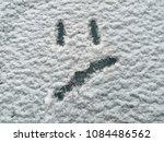 emoji painted on the snow  sad  ... | Shutterstock . vector #1084486562