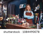 smiling florist with flowers in ... | Shutterstock . vector #1084490078