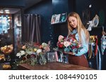 young florist with flowers in... | Shutterstock . vector #1084490105