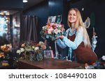 young girl in a flower shop | Shutterstock . vector #1084490108