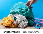 hand holding dirty laundry in... | Shutterstock . vector #1084500098
