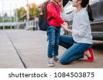 mother dressing up a son and... | Shutterstock . vector #1084503875