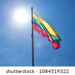 lithuanian flag and blue sky.... | Shutterstock . vector #1084519322