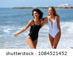 two young women with beautiful... | Shutterstock . vector #1084521452