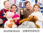family with stuffed elephant in ... | Shutterstock . vector #1084533425