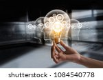 hand holding light bulb and cog ... | Shutterstock . vector #1084540778