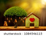 house model and red heart for... | Shutterstock . vector #1084546115
