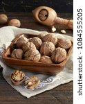 walnuts and nutcracker | Shutterstock . vector #1084555205