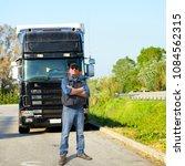 truck driver and truck | Shutterstock . vector #1084562315