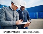 two engineers standing by... | Shutterstock . vector #1084563008
