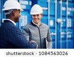 two smiling engineers wearing... | Shutterstock . vector #1084563026