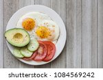 breakfast eggs on a white plate ... | Shutterstock . vector #1084569242