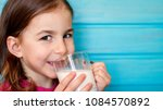 cute little girl enjoys the... | Shutterstock . vector #1084570892