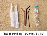 disposable water bottle  straws ... | Shutterstock . vector #1084576748