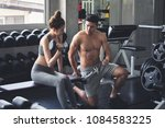 fitness man and asian woman... | Shutterstock . vector #1084583225