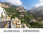 Small photo of Narrow street of beatiful town of Positano at Amalfi Coast, Ital