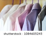 different colored men's shirts... | Shutterstock . vector #1084605245