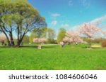 park in blur with people in... | Shutterstock . vector #1084606046