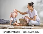 beautiful young woman and child ... | Shutterstock . vector #1084606532
