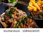 grilled beefsteak with french... | Shutterstock . vector #1084626035