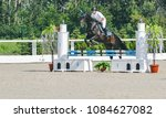 showjumping competition  bay... | Shutterstock . vector #1084627082