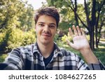 handsome young man smiling and... | Shutterstock . vector #1084627265