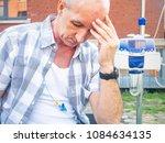 patient undergoing chemo... | Shutterstock . vector #1084634135