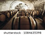 barrels of wine in a wine... | Shutterstock . vector #1084635398