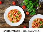 penne pasta in tomato sauce...   Shutterstock . vector #1084639916