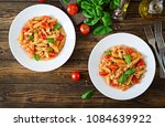 penne pasta in tomato sauce... | Shutterstock . vector #1084639922