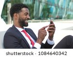 afro business man outside | Shutterstock . vector #1084640342