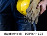helmet held by a construction... | Shutterstock . vector #1084644128