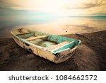 Abandoned Row Boat Along Shore...