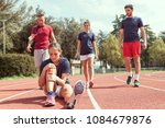 young athlete injured to knee... | Shutterstock . vector #1084679876