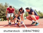 young athlete injured to knee... | Shutterstock . vector #1084679882