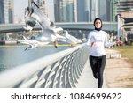 Arabic Woman Running Outdoor...