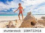 little girl at tropical beach...   Shutterstock . vector #1084722416