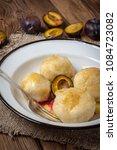 sweet plum dumplings in metal... | Shutterstock . vector #1084723082