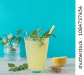 lemonade with lemon and mint ... | Shutterstock . vector #1084737656