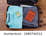 packing suitcase for vacation... | Shutterstock . vector #1084746512