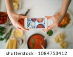 hands with the smart phone... | Shutterstock . vector #1084753412